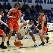 Xavier Riley, of Zanesville, chases after a loose ball during a 55-54 loss to visiting Marietta on Tuesday night at Winland Memorial Gymnasium.