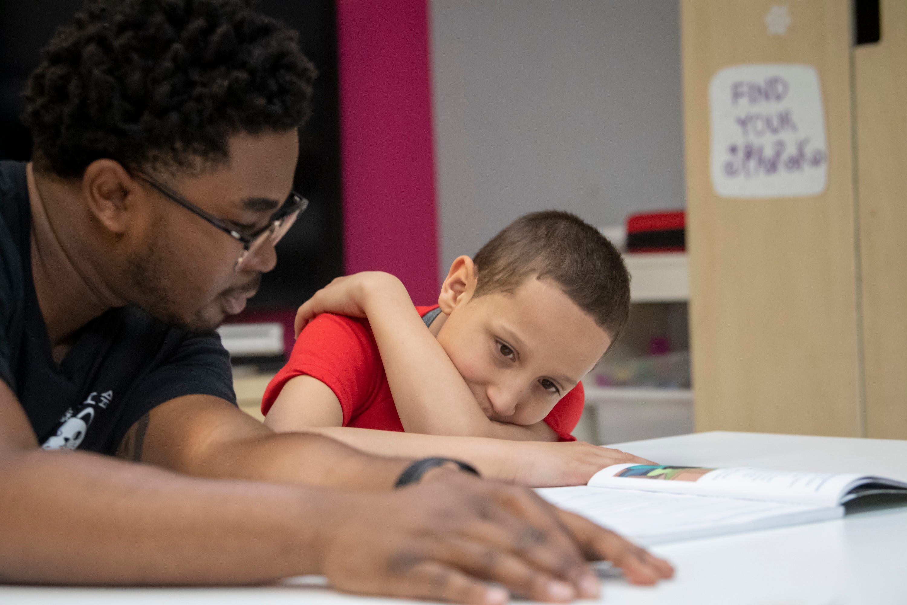 Professional mentor Rakim Isaacs, left, assists Landon Rodriguez in a reading exercise at Friends of the Children as part of a tutoring program. Rodriguez needs extra help because of his dyslexia diagnosis but is unable to get it at the public school he attends.
