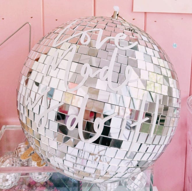 A disco ball can add glam to a reception.