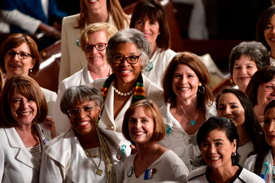 Congresswomen pose for a picture before President Donald J. Trump delivers the State of the Union address from the House chamber of the United States Capitol in Washington.