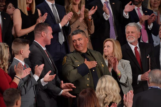 Deputy Chief Raul Ortiz is applauded as he sits in the First Lady's box as  President Donald J. Trump delivers the State of the Union address from the House chamber of the United States Capitol in Washington.