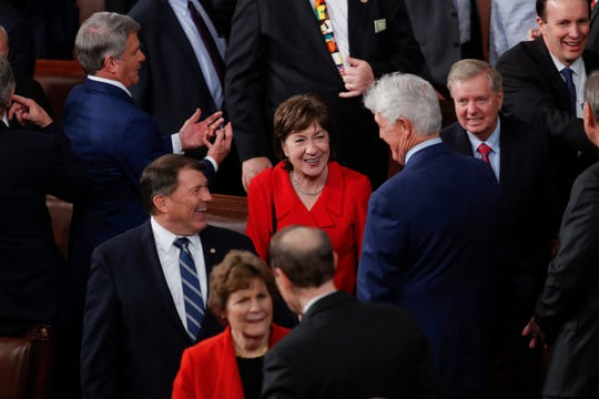 Sen. Susan Collins, R-Maine, center, flanked by her colleagues on Feb. 5, 2020.