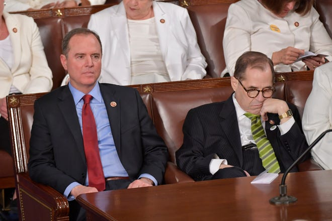 Rep. Adam Schiff (D-CA), left, and Rep. Jerry Nadler (D-NY) listen as President Donald J. Trump delivers the State of the Union address from the House chamber of the United States Capitol in Washington.