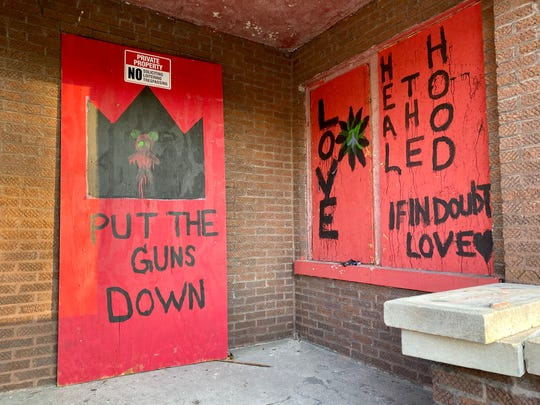 Abandoned homes painted by I Grow Chicago participants in Englewood, Chicago on Nov. 22, 2019.