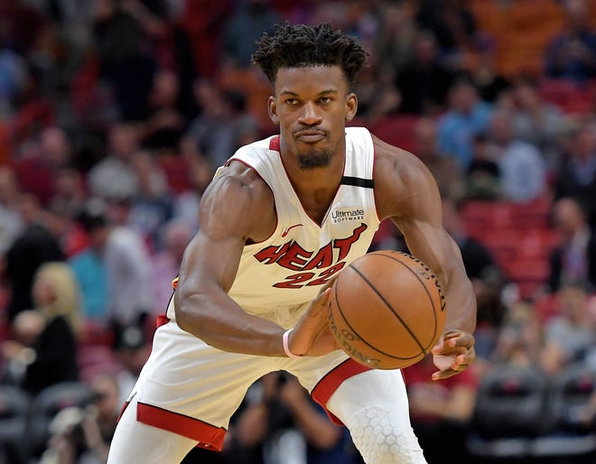 Miami Heat forward Jimmy Butler (22) against the San Antonio Spurs at American Airlines Arena.