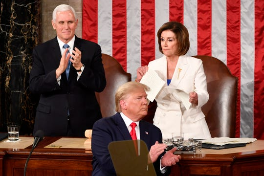 Vice President Mike Pence and House Speaker  Nancy Pelosi react after President Donald Trump concludes delivering the State of the Union address on Feb. 4, 2020.
