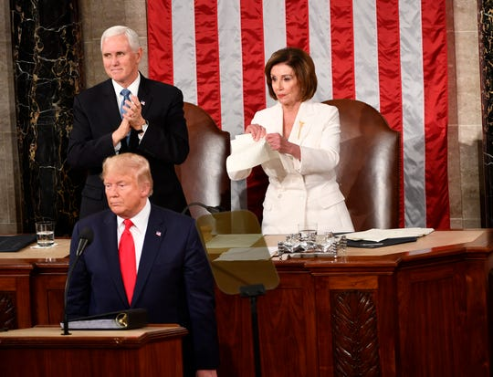 Speaker of the House Nancy Pelosi rips up the speech after President Donald J. Trump concludes delivering the State of the Union address from the House chamber of the United States Capitol in Washington.
