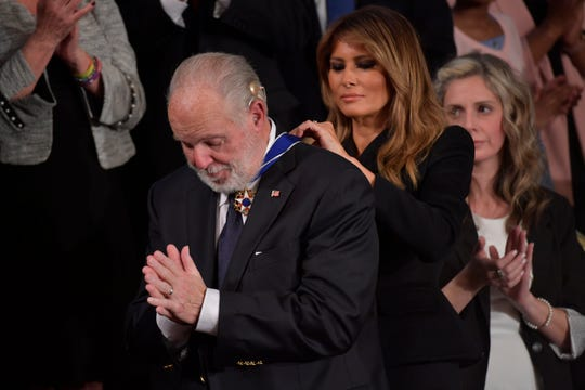 Rush Limbaugh receives the Medal of Freedom from First Lady Melania Trump as President Donald J. Trump delivers the State of the Union address from the House chamber of the United States Capitol in Washington.