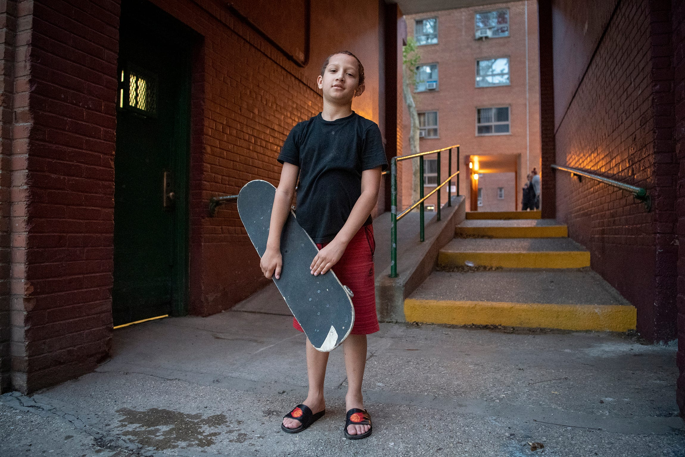 Landon Rodriguez outside the apartment building where he lives.