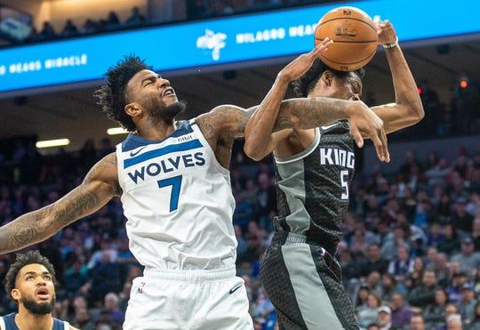 Feb 3, 2020; Sacramento, California, USA; Minnesota Timberwolves forward Jordan Bell (7) blocks a shot by Sacramento Kings guard De'Aaron Fox (5) during the fourth quarter at Golden 1 Center. Mandatory Credit: Ed Szczepanski-USA TODAY Sports ORG XMIT: USATSI-407466 ORIG FILE ID:  20200203_gma_bs4_342.jpg