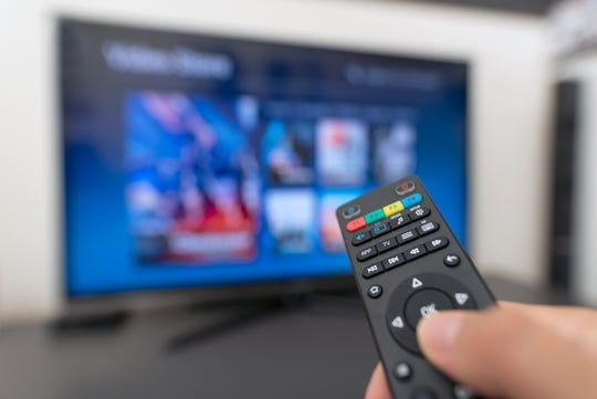 Before you ever turn on the TV, pick your remote up with a tissue or gloves, put it in a plastic bag and zip it shut. You can still operate the remote, but never have to actually touch the surface of one of the germiest items in the room.
