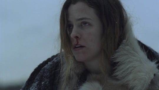 """Grace (Riley Keough) is stuck in a snowed-in house with her fiance's children when things go awry in """"The Lodge."""""""