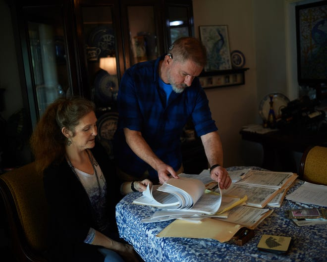 Darla Markley and her husband, Andy Markley, review their medical paperwork. Even after Mayo wrote off some of what they owed, Darla's disability and Social Security checks barely covered her insurance premiums. By 2014, five years after her initial hospitalization, they had no choice but to declare bankruptcy.