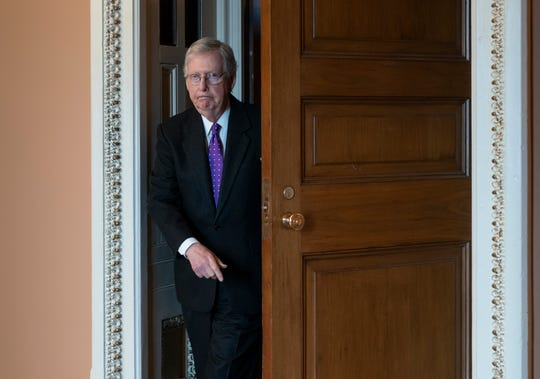 Senate Majority Leader Mitch McConnell, R-Ky., returns to his office as Republican senators leave a closed-door strategy session at the Capitol on Feb. 4, 2020.