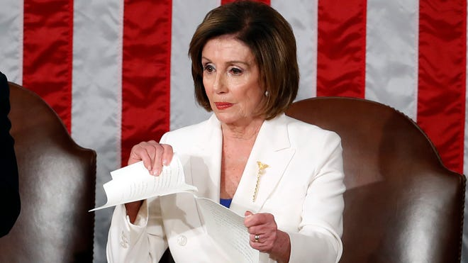 House Speaker Nancy Pelosi, D-Calif., tears her copy of President Donald Trump's State of the Union address after he delivered it to a joint session of Congress on Capitol Hill in Washington, Feb. 4, 2020.