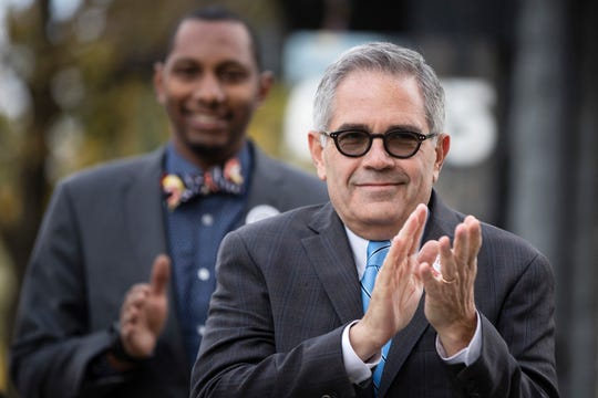 Philadelphia District Attorney Larry Krasner, shown here in 2017 as he heads to the polls, has drawn the ire of President Donald Trump and police unions who accuse the reform-oriented DA of being soft on crime.
