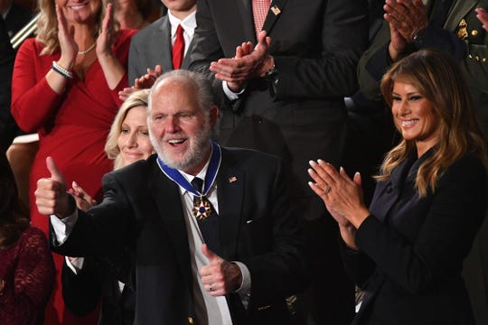 Radio personality Rush Limbaugh gives a thumbs-up after being awarded the Medal of Freedom by first lady Melania Trump after being acknowledged by President Donald Trump during the State of the Union.