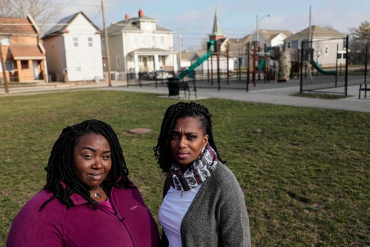 Marian Stuckey, section chief of neighborhood social services for Columbus Public Health and head of the Columbus CARE Coalition, left, and Crystal Turner, a CARE volunteer and victim of gun violence, right, pose for a portrait on Tuesday, January 14, 2020 at Southside Settlement Heritage Park in Columbus, Ohio.