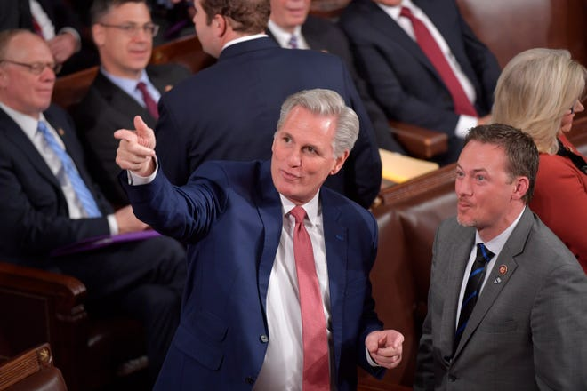 US House Minority Leader Kevin McCarthy (R-CA) gestures before President Donald J. Trump delivers the State of the Union address from the House chamber of the United States Capitol in Washington.