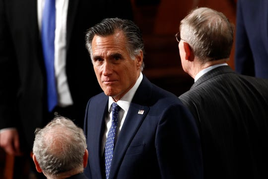 Sen. Mitt Romney, R-Utah, arrives before President Donald Trump delivers his State of the Union address to a joint session of Congress on Tuesday.
