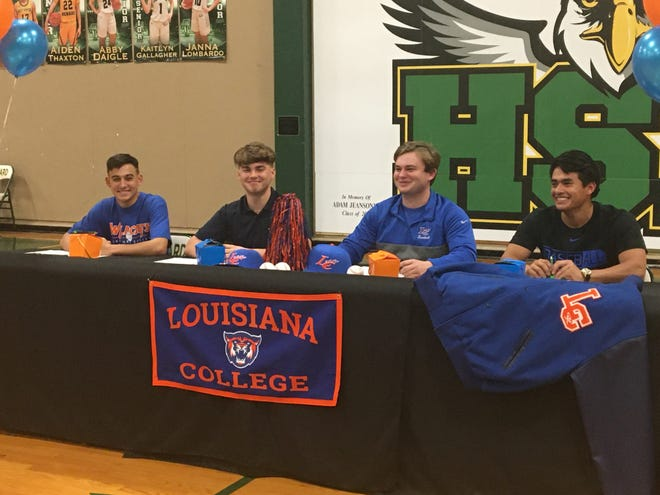 Menard baseball players Dru Scully (left), Cade Moreau, Austin Thiels and Kaleb Zimmerman signed with Louisiana College Tuesday.