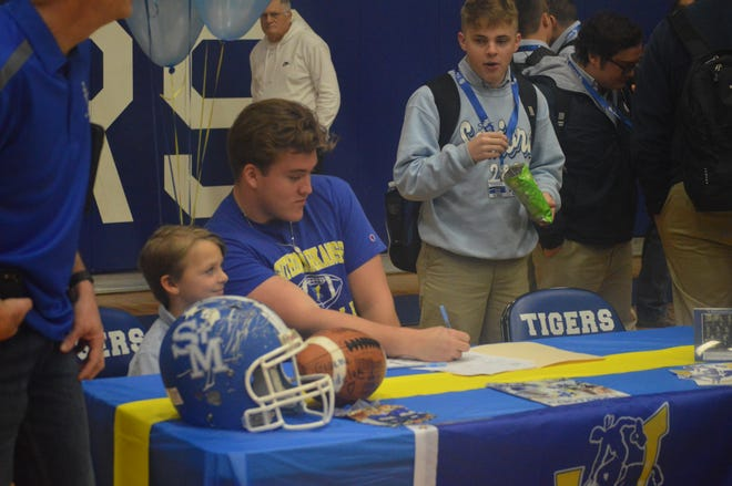 St. Mary's lineman Damon LeGrande (center) signed with Southern Arkansas Wednesday.