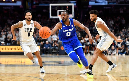 Seton Hall Pirates guard Quincy McKnight (0) dribbles between Georgetown Hoyas guard Jahvon Blair (0) and guard Jagan Mosely (4)