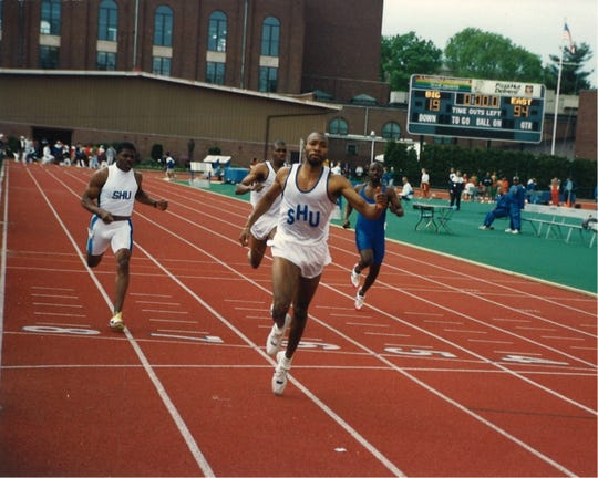 Kevin Lyles winning a race for Seton Hall track
