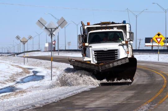 A snowplow from the Texas Dept. of Public Transportation clears the shoulder on the U.S. 83/84 west frontage road right before Iberis Road.
