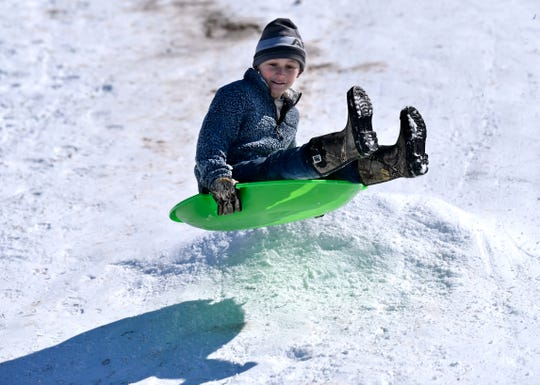 Creede Walton, 9, catches air as he goes off a mound of snow at Wild Cat Disc Golf Course on Thursday. Overall, Abilene received 3.5 inches of snow.