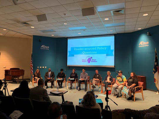 Asheville City Council candidate forum on Feb. 5, 2020, at AB Tech's Ferguson Auditorium. From left to right are Kristen Goldsmith, Councilman Keith Young, Sandra Kilgore, Kim Roney, Shane McCarthy, Rich Lee, Sage Turner, Larry Ray Baker and Nicole Townsend.