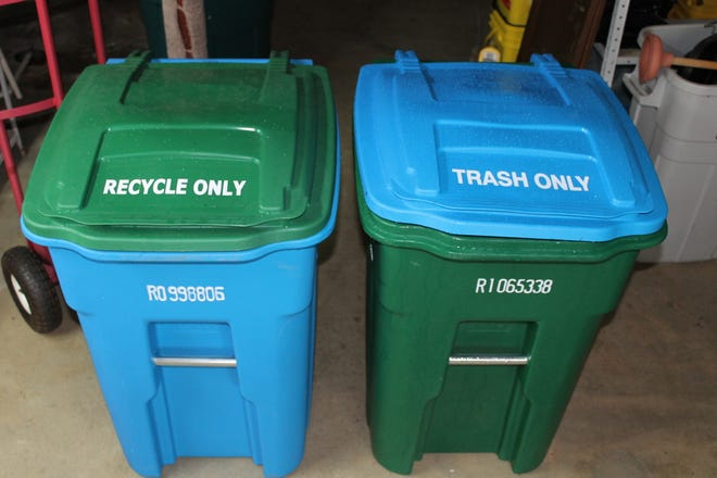 Several readers have asked why Waste Pro's new rolling bins have seemingly mismatched lids and cans.