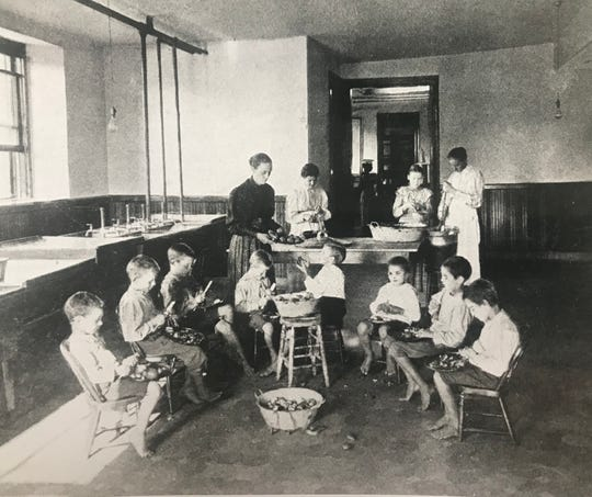 "This undated photo shows ""an every-day kitchen scene"" at the Haskell Home. The orphanage burned on Feb. 5, 1909, killing three children."