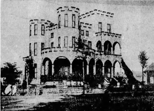 A 1938 image of the house that was operating as an apartment  building at that time.