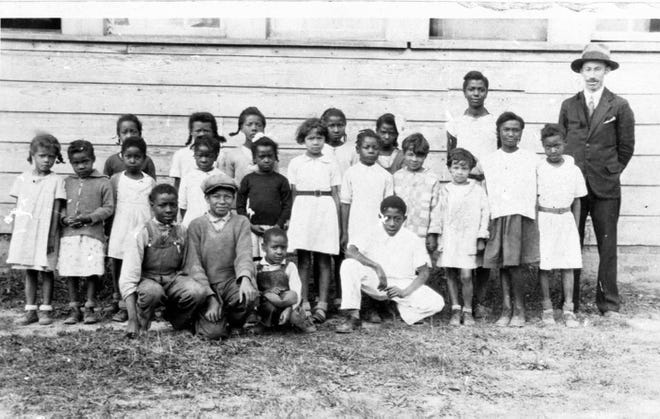 By 1928, one-third of the South's rural Black school children and teachers were served by Rosenwald Schools. One of these schools was in Swannanoa. This photograph shows the school and some of its students in the 1930s.