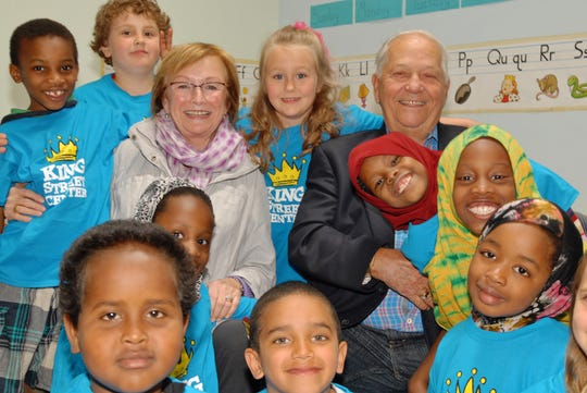 Holly Bobby Miller huddle with kids at King Street Center in Burlington during a fundraising campaign kick-off in 2013.