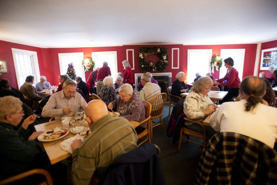 Diners enjoy a free Christmas dinner at Mary's at Baldwin Creek in Bristol  in 2012.