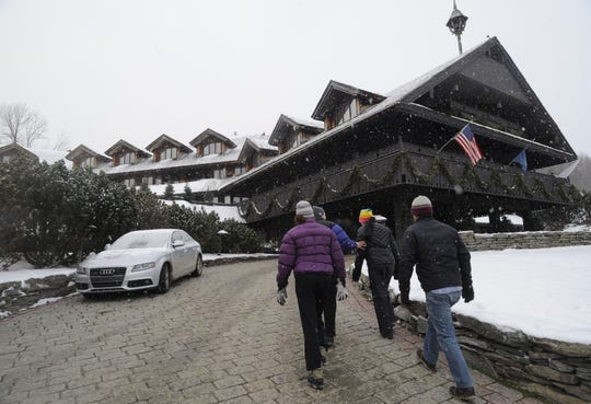 Guests enter the Trapp Family Lodge in Stowe on Friday, January 2, 2009.