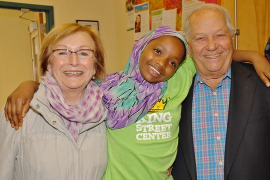 Holly Miller, Nurto Hassan, Bobby Miller celebrate a King Street Center fundraising campaign kick-off in Burlington in 2013.
