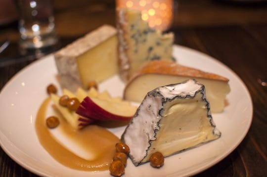 Cheese from Eleven Brothers, Pyramid Scheme, Landau and Madison at the end of a three-course dinner at Hen of the Wood in Waterbury on Thursday, March 31, 2016.