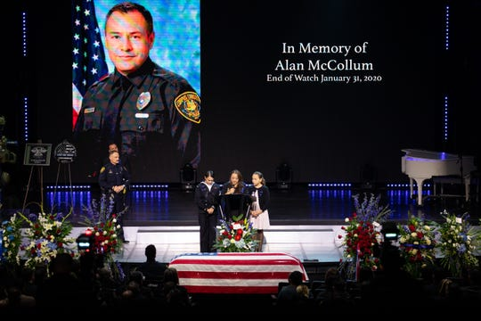 Michelle McCollum, wife of fallen Corpus Christi Police Officer Alan McCollum, is surround by their daughters as she speaks to service attendees on Thursday, Feb. 6, 2020.