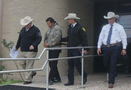 Victor Trevino Jr. was arrested Wednesday in connection with the murder of Ernesto Salinas on San Felipe Street. Investigators Alan Gonzalez and Gilbert Saenz along with Texas Ranger Matt Seguir walked Trevino to the JWC jail.
