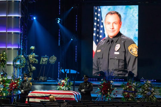 The casket bearing Officer Alan McCollum is guarded by Corpus Christi honor guard officers at Church Unlimited on Friday, Feb. 6, 2020.