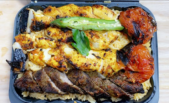 Deluxe kabab, with fire grilled beef and chicken marinated in a specialty sauce, with a side of grilled tomato, onions, and pepper, at Express Shish Kabab in Pennsauken.