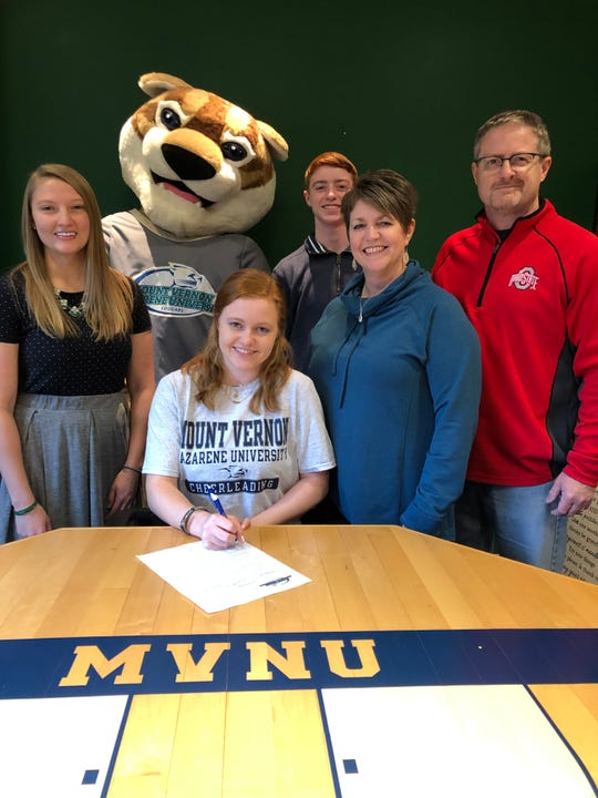 Maggie Carpenter of Deer Park signed her letter of intent to cheer for Mount Vernon Nazarene University. With her (seated) are, from left: Melissa Nowicki (head cheer coach at MVNU), Braxton Carpenter (brother),  Beth Carpenter (mother) and Keith Carpenter (father).