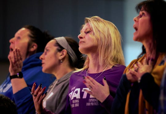 "Amie Detzel, 35, worships at Vineyard Westside in Cheviot, Sunday, January 19, 2020. Detzel, now a year in recovery, started using a variety of drugs as a teenager due to being sexually abused by a friend of the family. ""I am definitely a survivor of human trafficking."" Later, she turned to shooting meth. ""I just wanted to try anything, anything that I thought would take me to another level. I just wanted to escape from what I was feeling."""