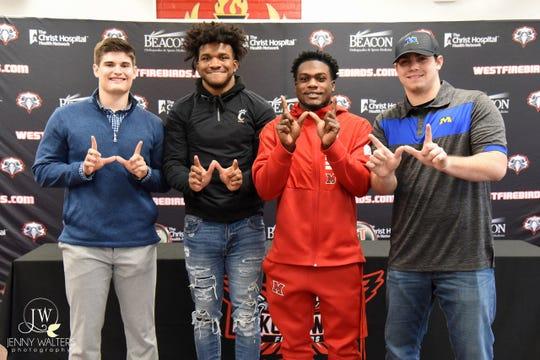 Lakota West's football signees are, from left: Isaac Kolosik (Butler University), Daved Jones (University of Cincinnati), David Afari (Miami University) and Jake Kieffer (Morehead State). Jones and Afari signed in December.