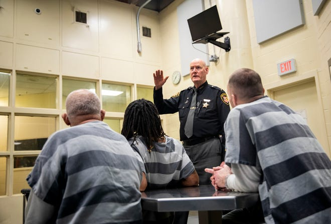 Sheriff Jim Neil talks to inmates in the men's recovery pod Thursday afternoon at the Hamilton County Justice Center in downtown Cincinnati.