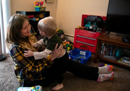 Brittany Christian, 32, plays with her son, Kyler, 2, at her Walnut Hills home. Christian moved from heroin to meth use and then got help. She's been drug-free for 18 months and has Kyler back.
