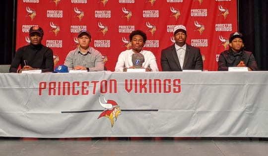 Princeton athletes signed their letters of intent to play college football Feb. 5. They are, from left: Kevin Suttles, University of Findlay; Christin Kilgus-Dixon, Urbana University; Dorian Durham, Urbana University; Brandon Williams, Tiffin University; and Jaeden Scarborough, Lake Erie College